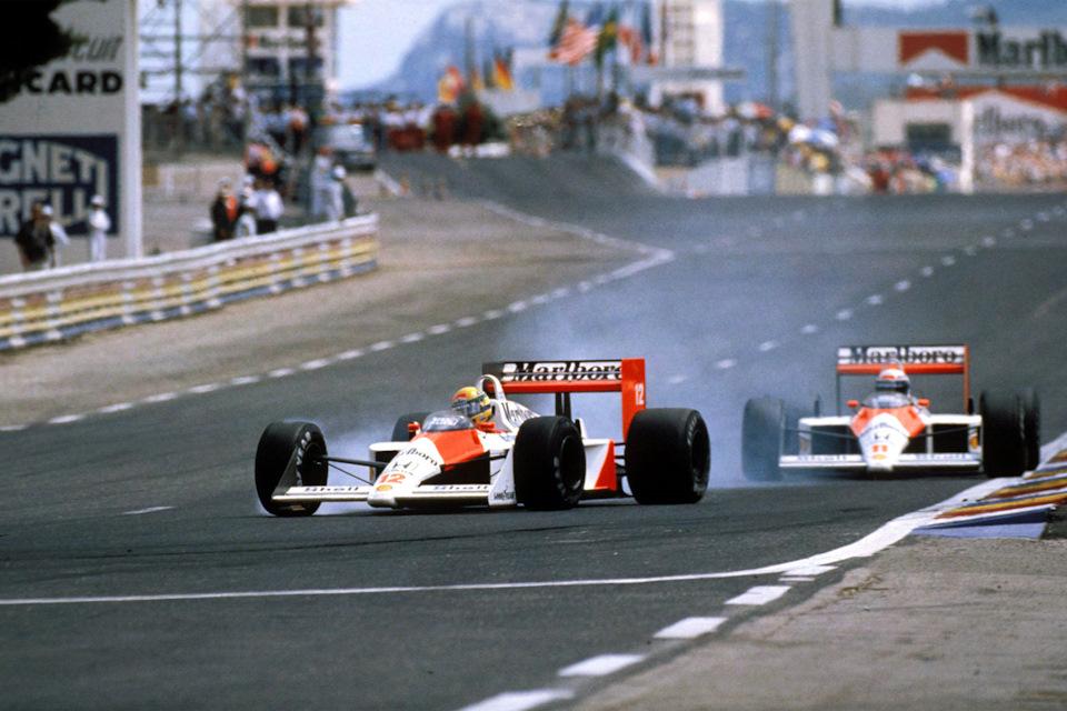 Ален Прост (#11) прессингует Айртона Сенну (#12) в своей домашней гонке – Гран При Франции '88