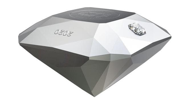 монета в форме бриллианта